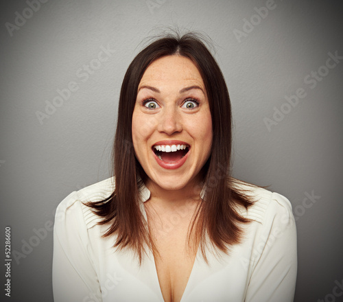 happy woman looking at camera