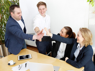Successful people in a meeting show a strong company