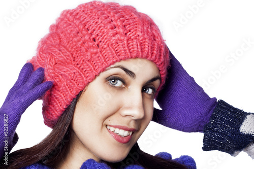 Portrait of beautiful happy woman in winter hat