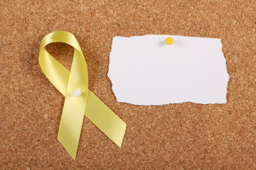 Yellow Ribbon and Blank Card on Cork Board