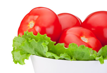 Close-up Fresh tomatoes with green salad leaf in Bowl isolated o