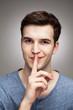 Man making silence gesture
