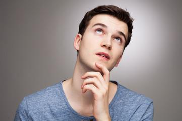 Young man wondering