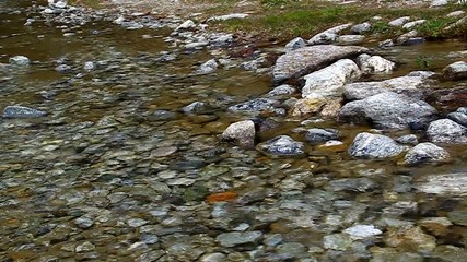 With its clear water stream flowing over rocks