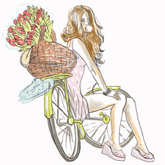 Girl resting on a bicycle and blowing bubble