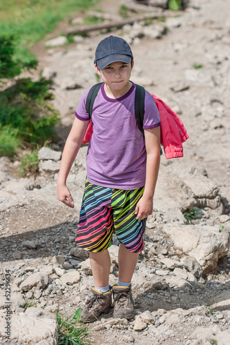 Boy on mountain trail