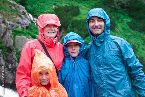 Family on mountain trail on a rainy day