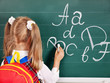 Schoolchild writting on blackboard