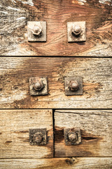 nuts and bolts on weathered wood