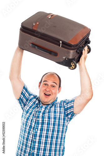 Ecstatic traveler lifting up his luggage