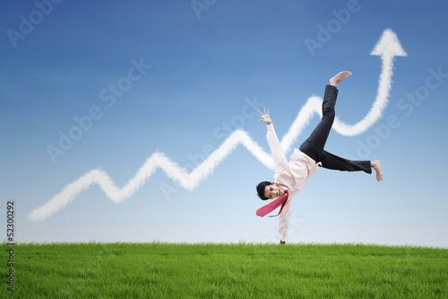 Happy businessman dance on profit chart cloud