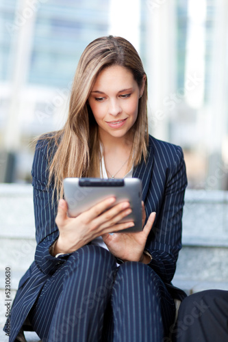 Successful young businesswoman using a laptop