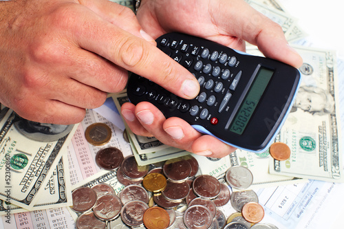 Hand with calculator and money.
