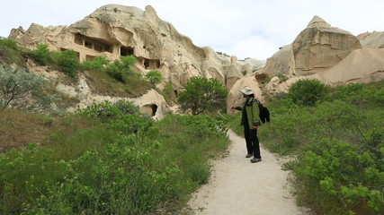 Tourist watching cave house Famous city  Cappadocia