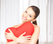 woman with red heart-shaped pillow