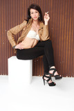 Sensual girl with a brown leather jacket and leggings blacks
