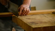 Luthier, carpenter, craftsman, cuts wood for guitar mastil's