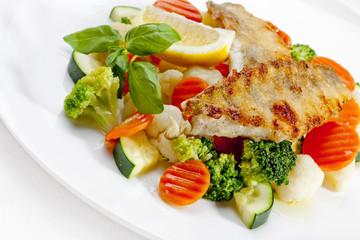 A Tasty food .Grilled fish and vegetables. High quality image