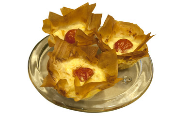 Small homemade cheese and cherry tomato pies in pastry basket