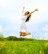 Happy Young Woman Jumping over blue sky. Beauty Girl Having Fun