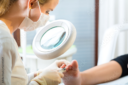 Woman in poidatry studio receiving pedicure