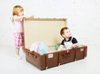 Boy and Girl in Suitcase