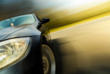 Front side view of black car with heavy blurred motion. - 52307269