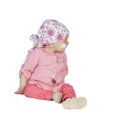 Adorable baby with a headscarf beating the disease