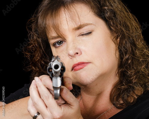 Woman holding loaded gun