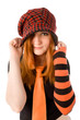 Red haired girl in knit hat