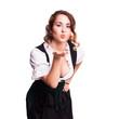 attraktive junge Frau im Dirndl mit Kuss-Geste