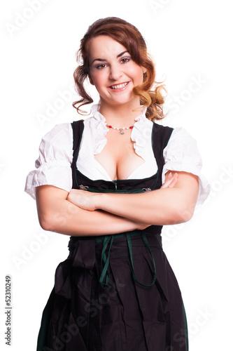 attraktive junge Frau im Dirndl mit verschränkten Armen