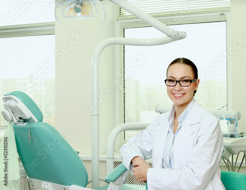 Dentist doctor smiling in camera