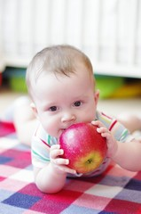 baby boy eats apple