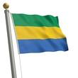 Die Flagge von Gabun flattert am Fahnenmast