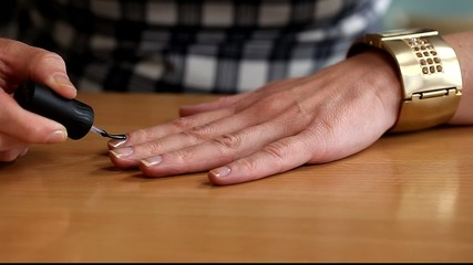 Woman apply top  coat nail polish/episode 1/