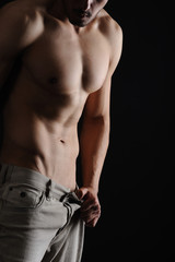 Sexy Muscular Man isolated black background
