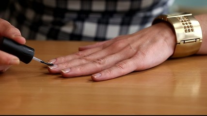 Woman apply top  coat nail polish/episode 2/