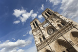 Notre Dame Cathedral in Paris with dramatic blue sky