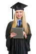 Smiling young woman in graduation gown using tablet pc