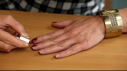 Woman apply red nail polish /episode 1/