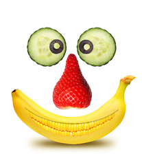 Face from fruits isolated over white background