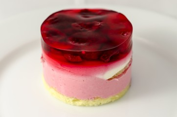 Raspberry dessert on white plate