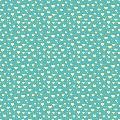 Seamless pattern of hearts and snow.