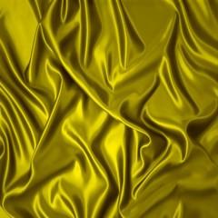 Sábana de seda amarilla.