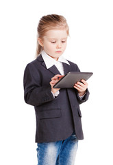 little girl in a business suit working on the tablet. isolation