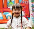 Leinwanddruck Bild - Portrait of beautiful young girl on the playground.