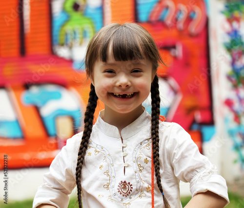 Leinwanddruck Bild Portrait of beautiful young girl on the playground.