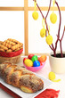 Easter sweet bread with multicolored eggs and shortbread cookies