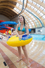 Woman with swimming toy at the water park.